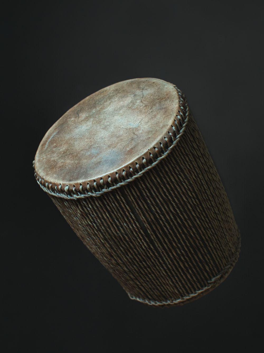 brown wooden round container on black surface