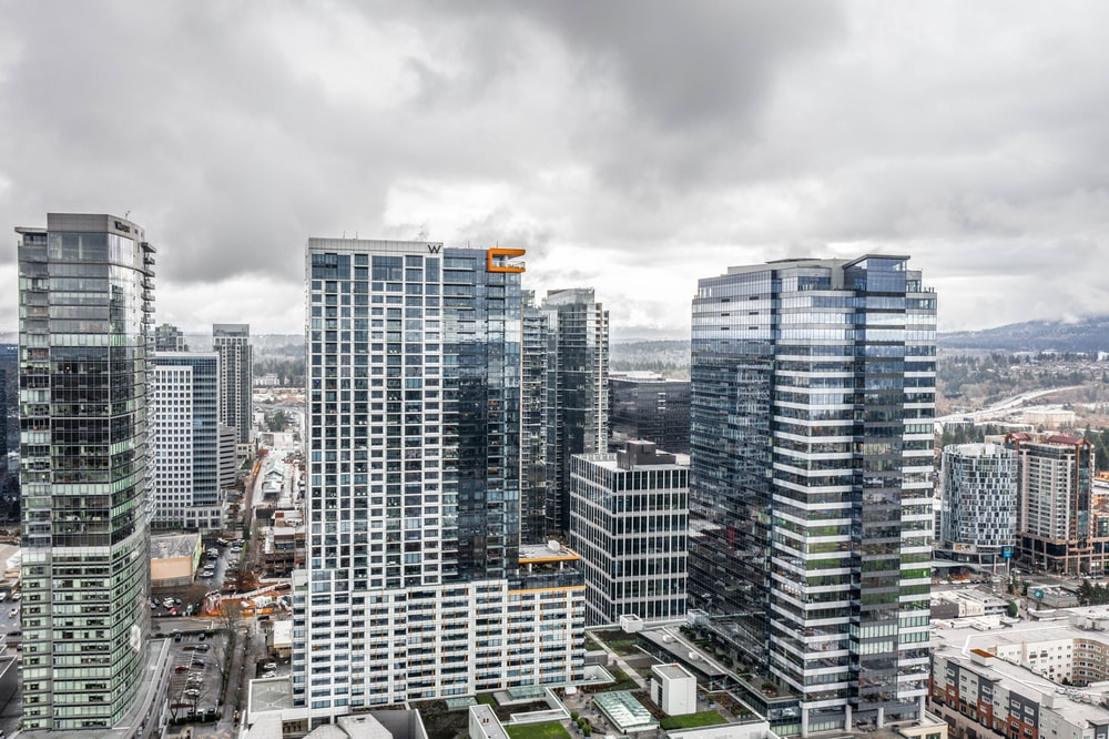 high rise buildings under gray sky during daytime