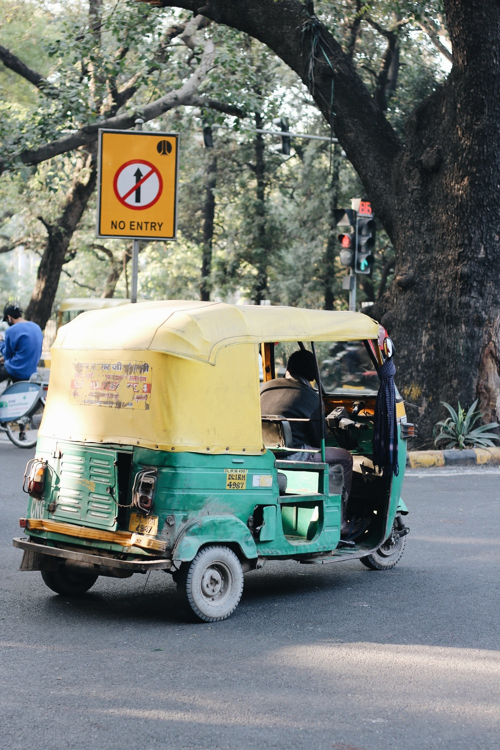 green and white auto rickshaw on road during daytime