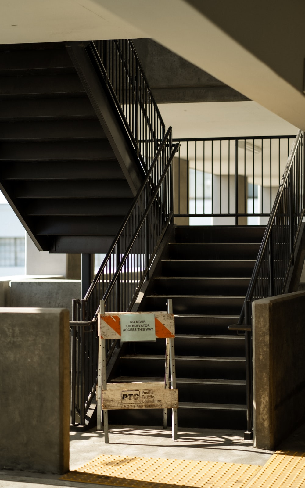 brown wooden table on gray concrete staircase