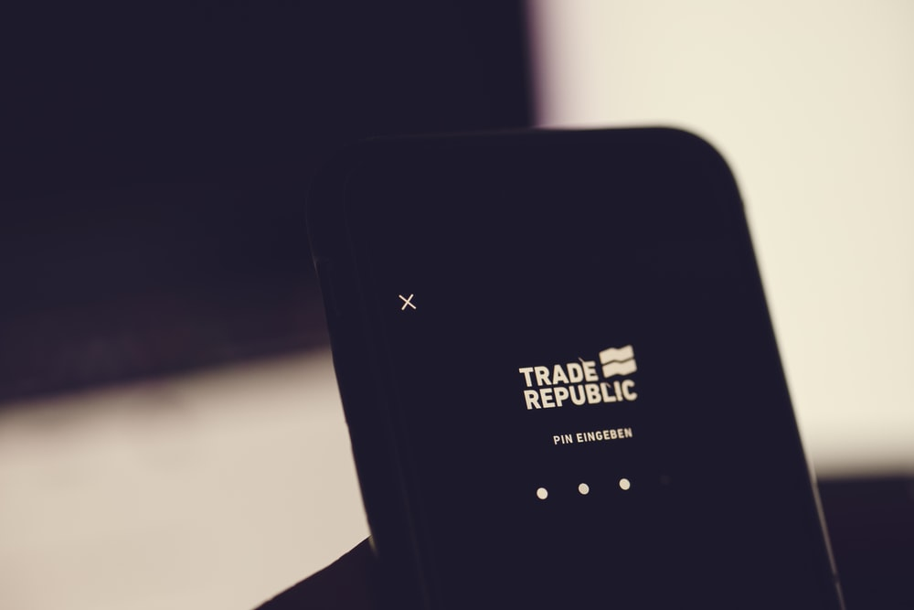 black wireless router on white table