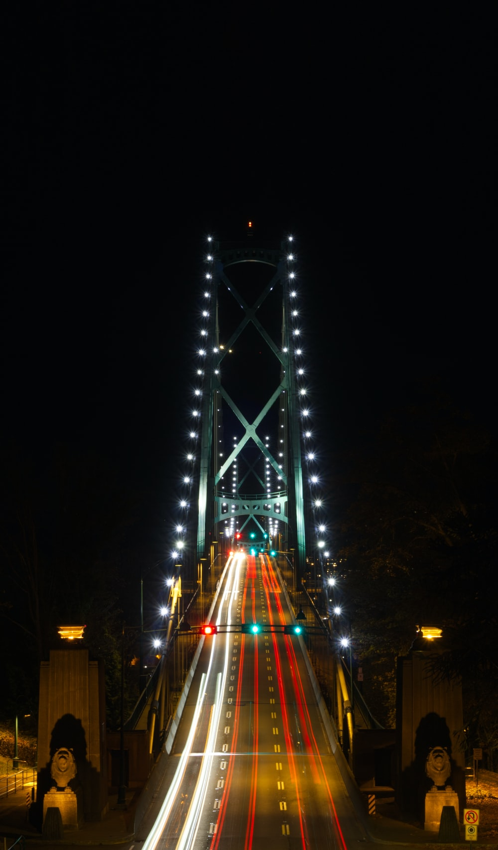 blue lighted bridge during night time