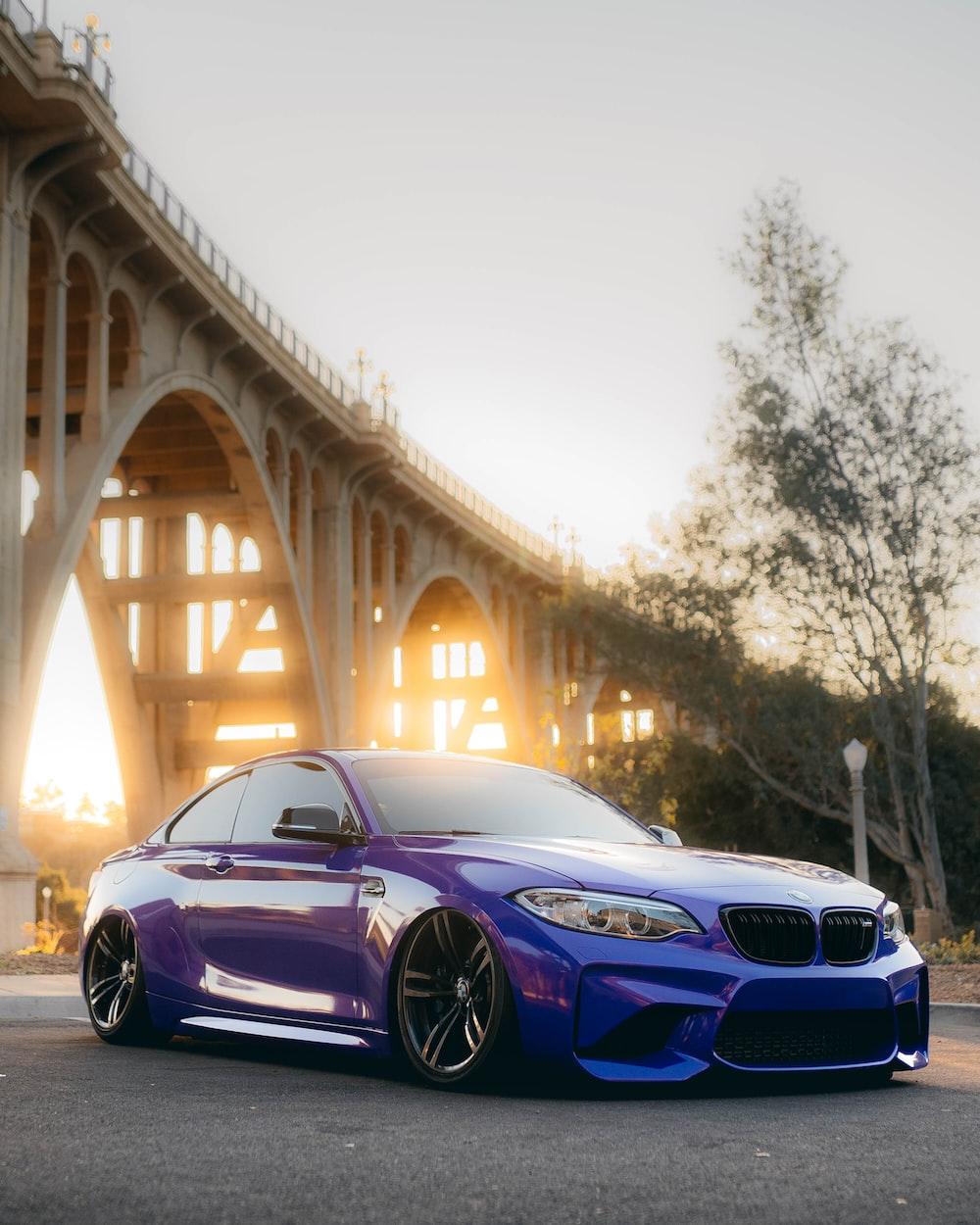 purple bmw m 3 coupe on bridge during daytime