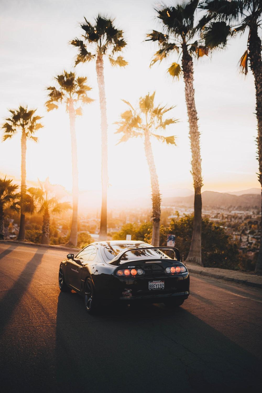 black porsche 911 on road during sunset