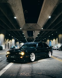black bmw m 3 on road during night time