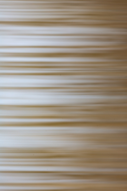 brown and white stripe textile
