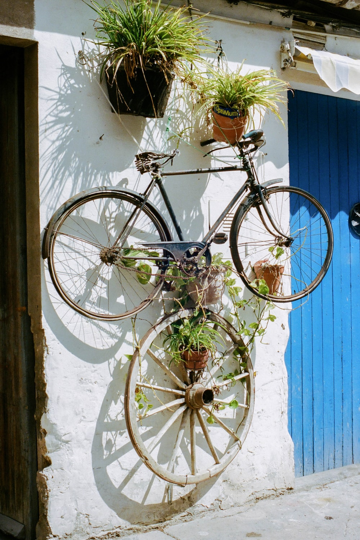 blue city bike on white wall