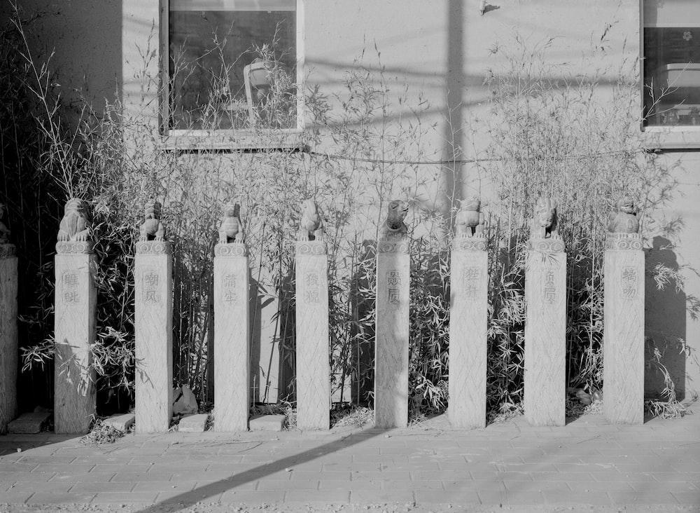 gray scale photo of white cross