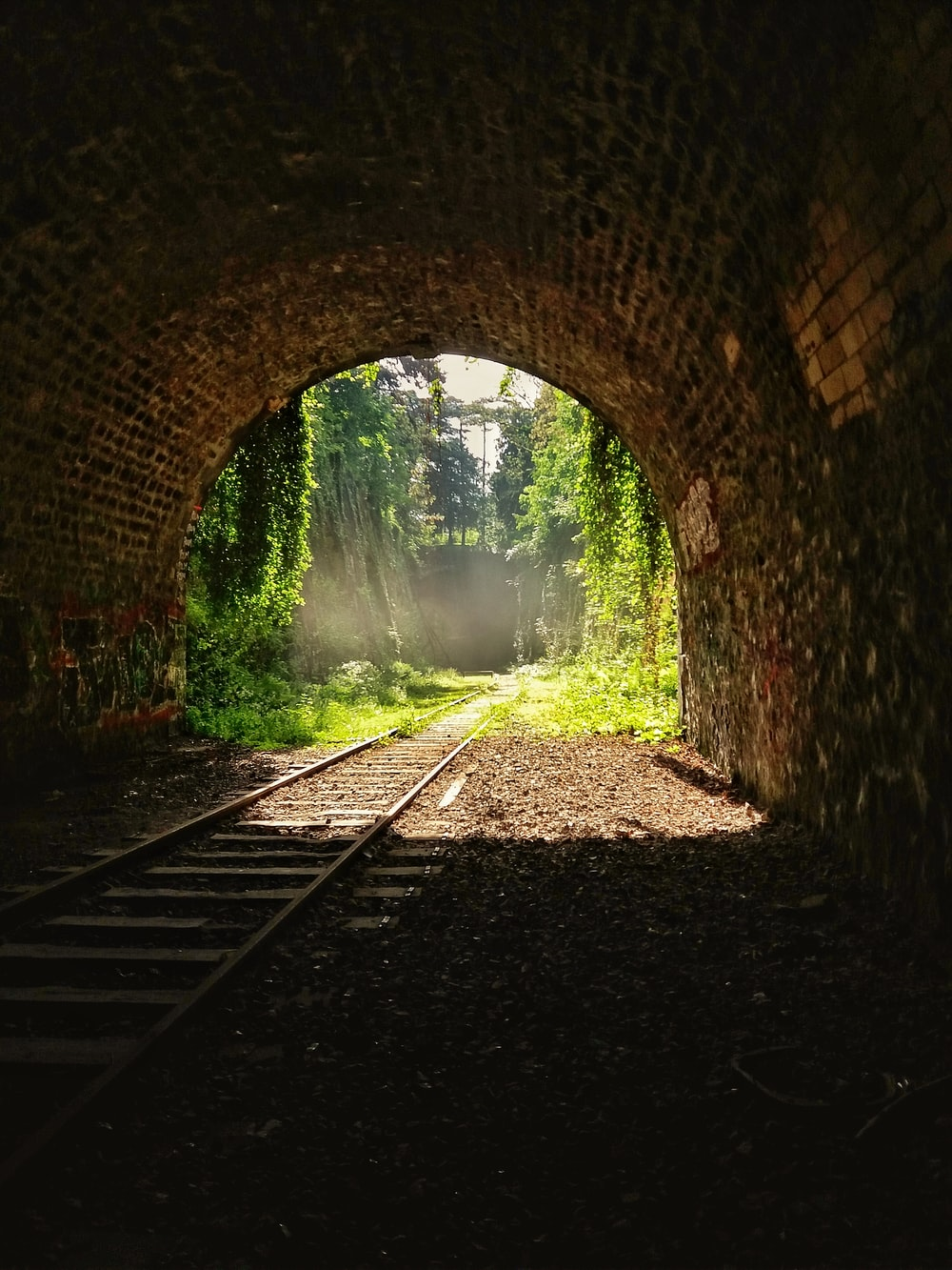 brown and black brick tunnel