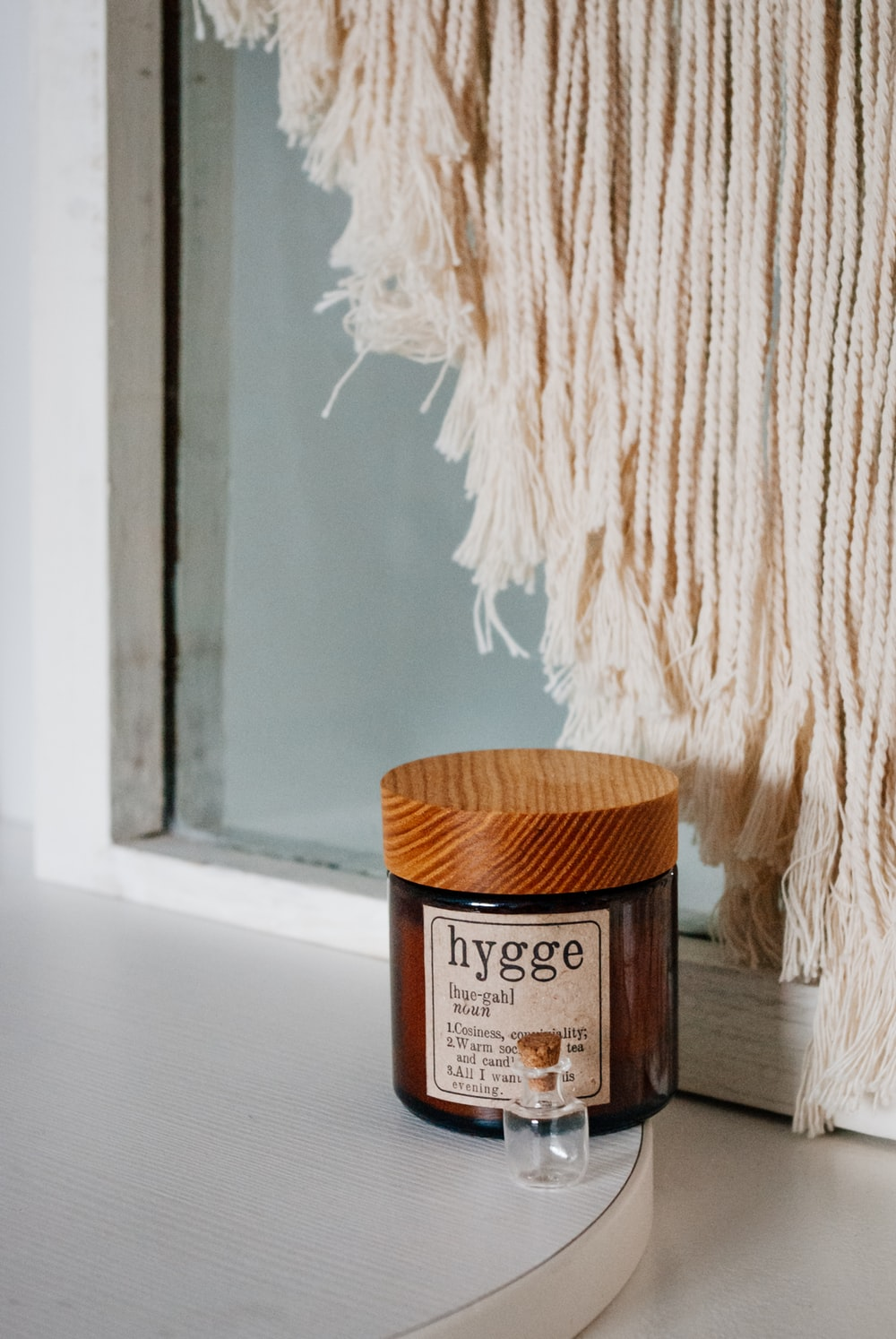 brown wooden container beside white textile