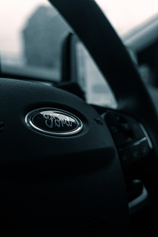 black nissan car steering wheel