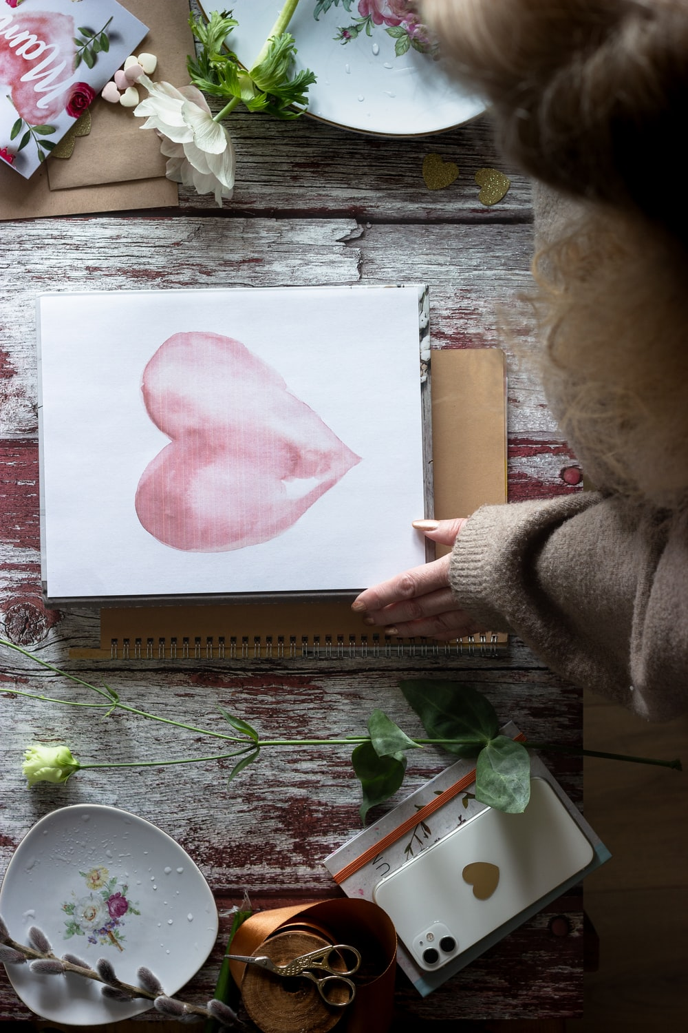 pink heart painting on brown wooden table