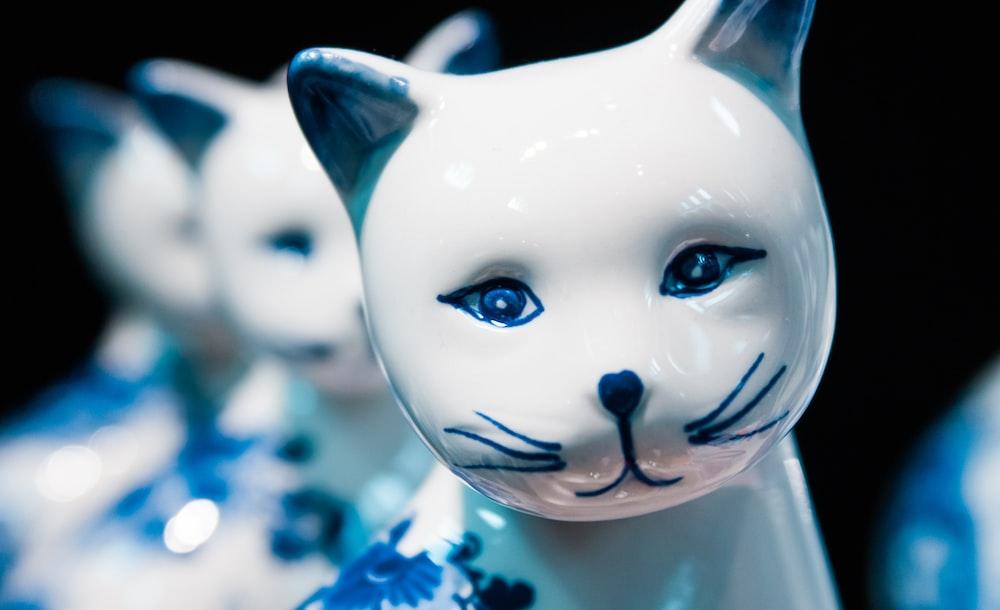 white and black cat figurine