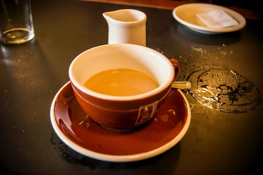 brown ceramic teacup on saucer