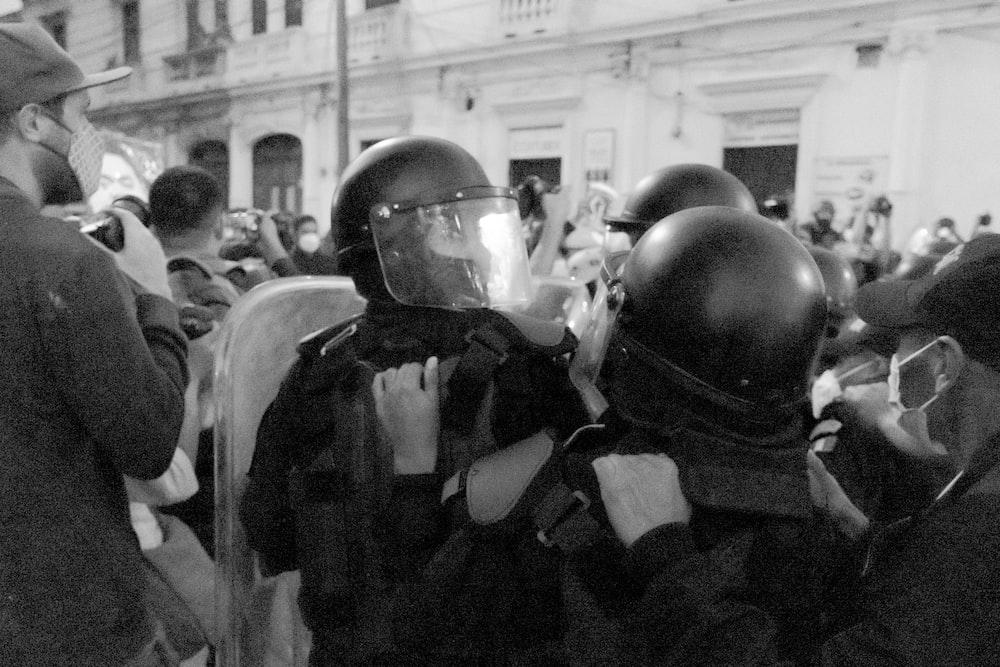 grayscale photo of man in black helmet