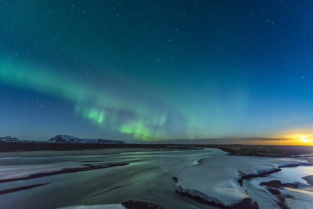 green and blue sky with stars