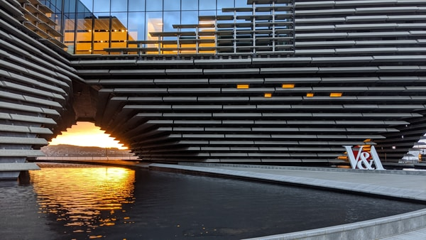 V&A Dundee Design For Business. gray metal frame on body of water during sunset