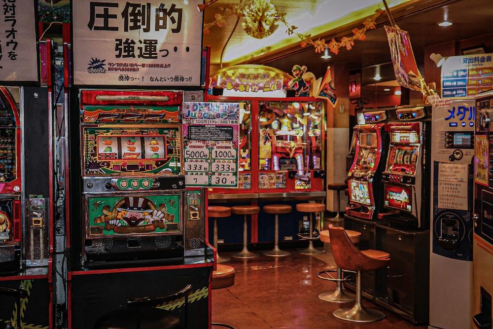 arcade machine near brown wooden chair