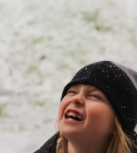 smiling girl in black knit cap