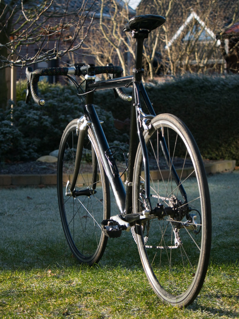 black and silver bicycle on green grass field during daytime