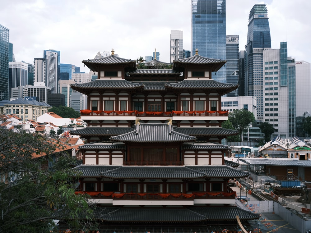 red and black temple near city buildings during daytime