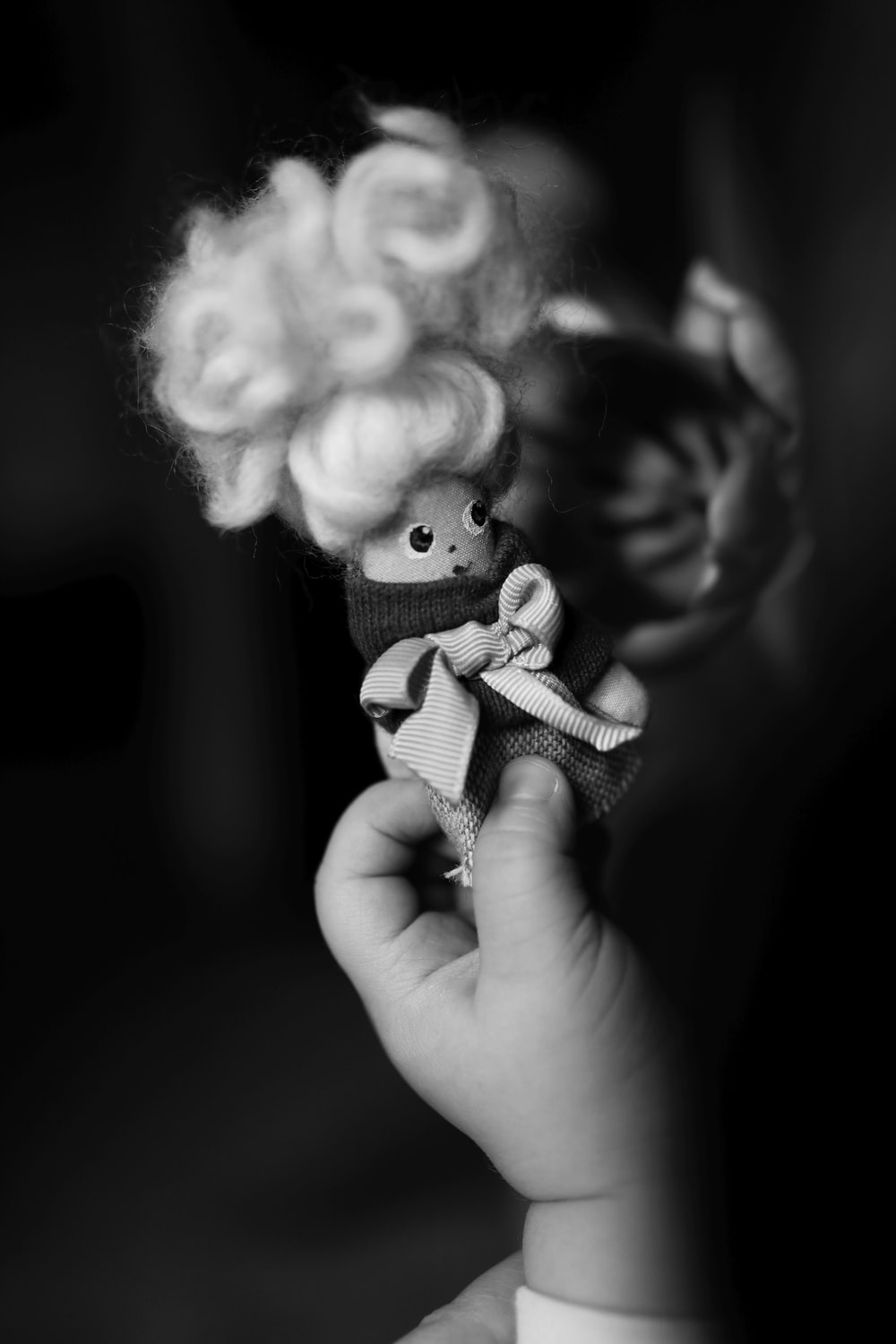 grayscale photo of girl doll