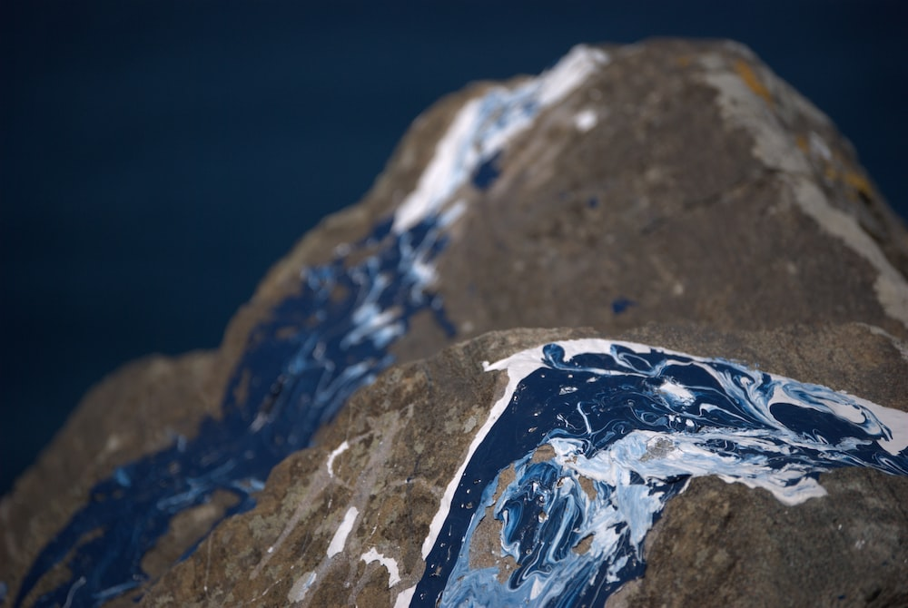 white and blue ice on gray rock