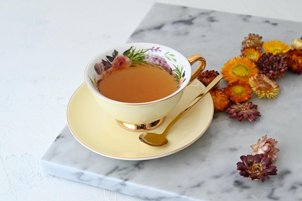 white ceramic teacup on white ceramic saucer