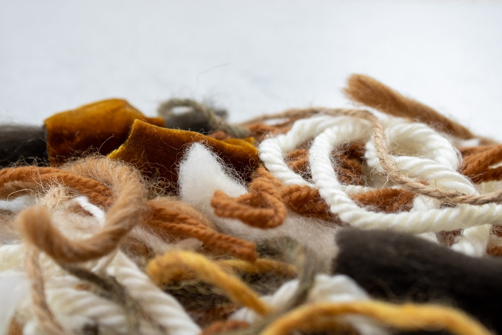 white and brown rope on white textile