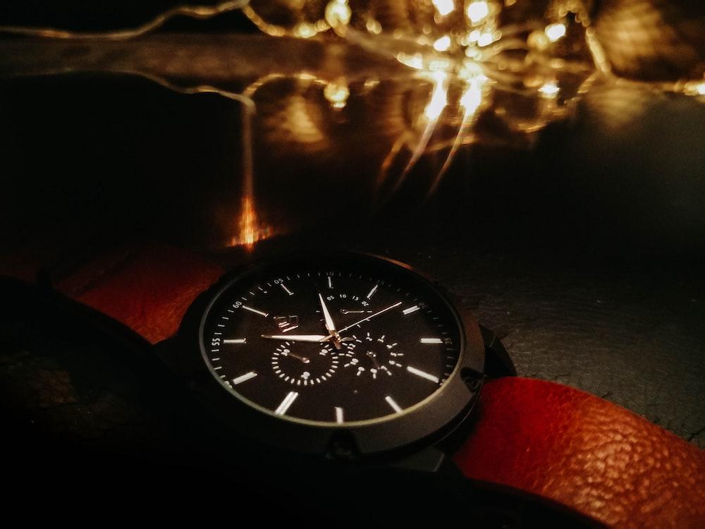black round analog watch at 10 00