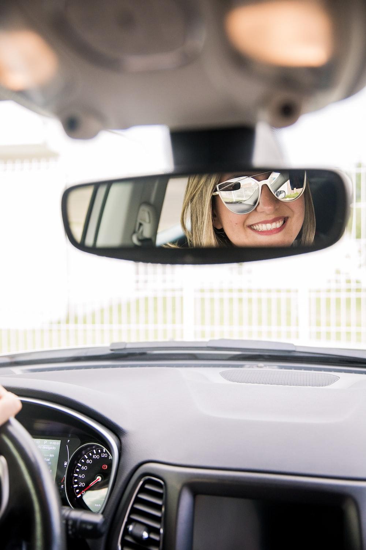 woman in black sunglasses in car