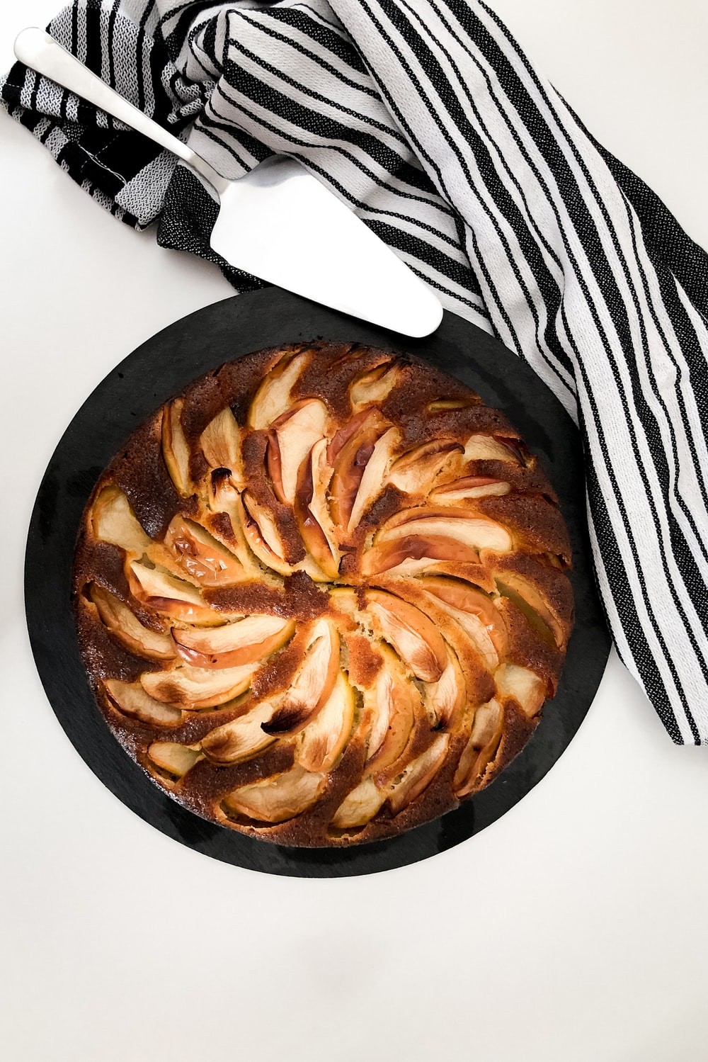 brown and white pastry on black plate