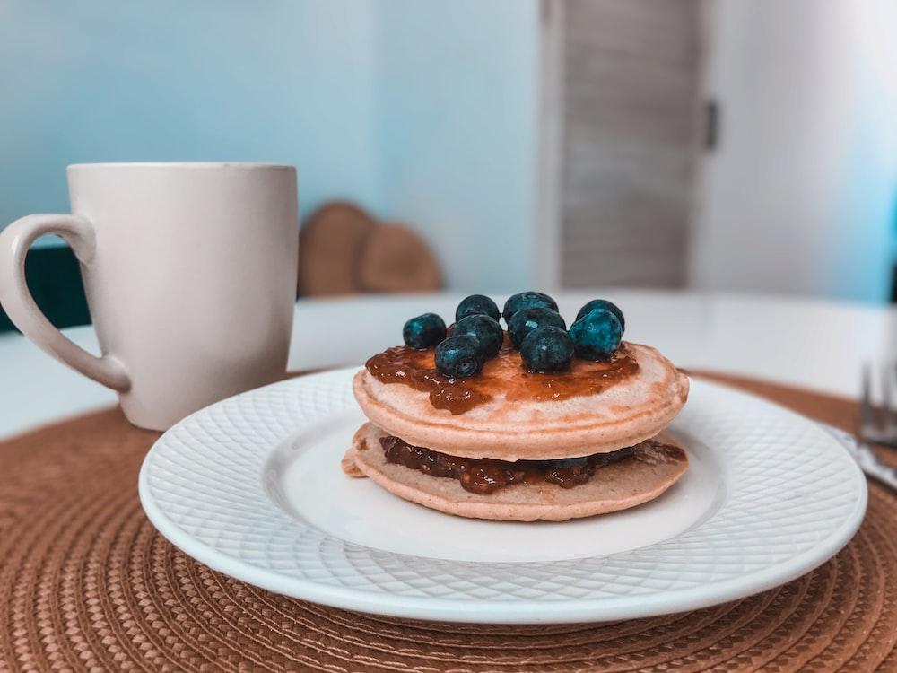 three cupcakes on white ceramic plate
