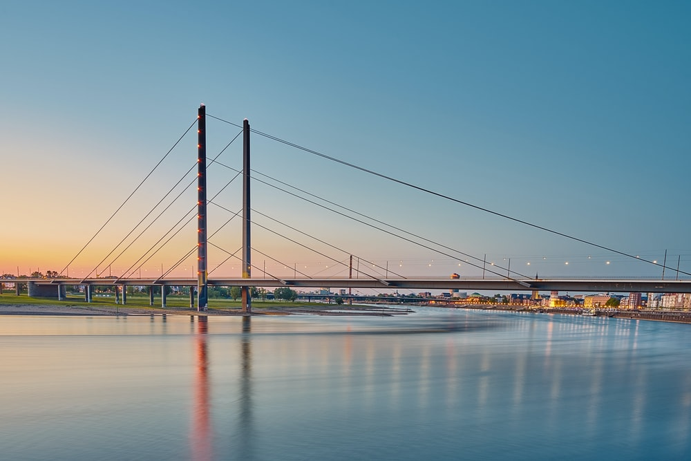 bridge over water under blue sky during daytime