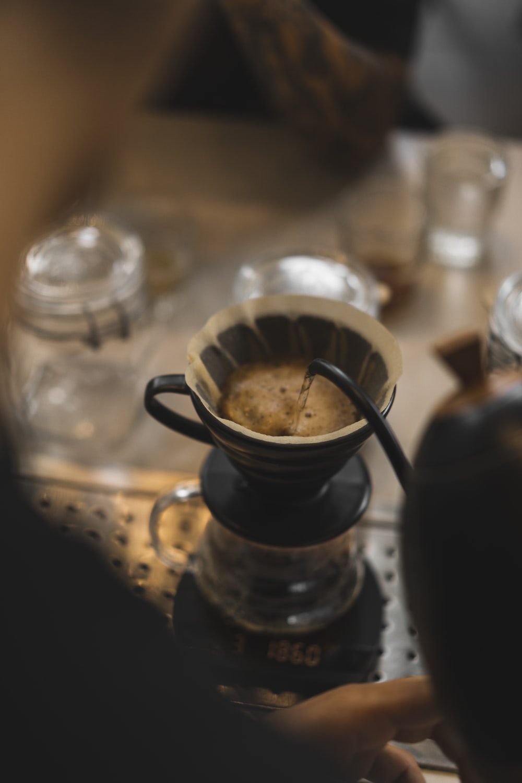 black liquid in clear glass cup