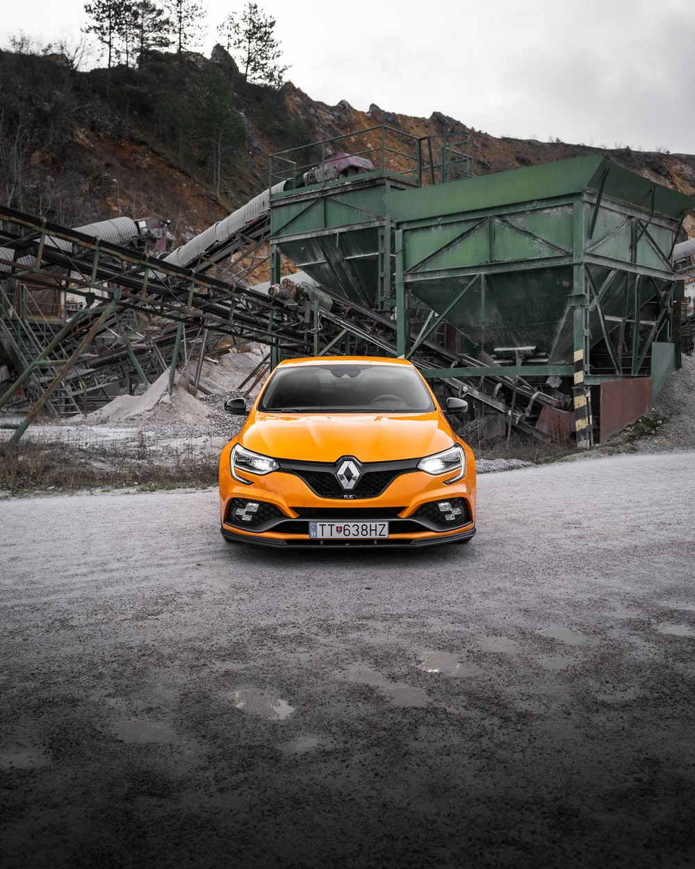 yellow car on gray asphalt road during daytime