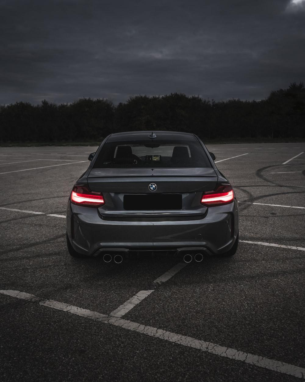 black car on gray asphalt road during daytime