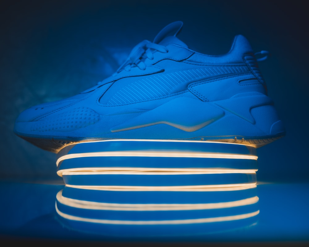 blue and white nike athletic shoes