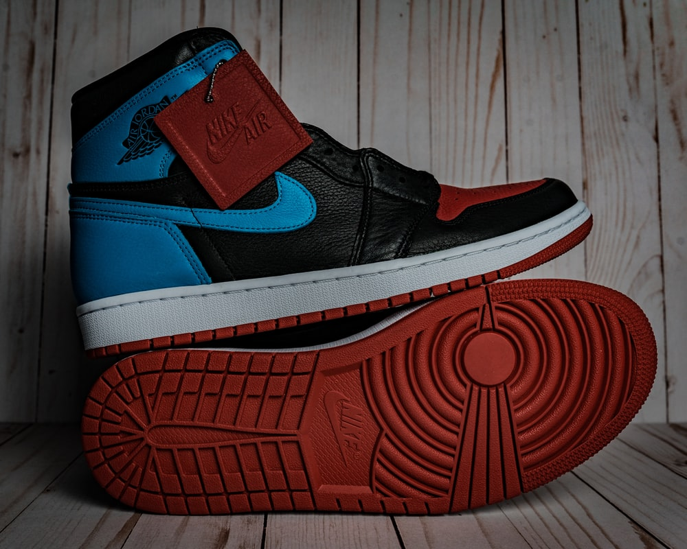red and blue nike athletic shoe