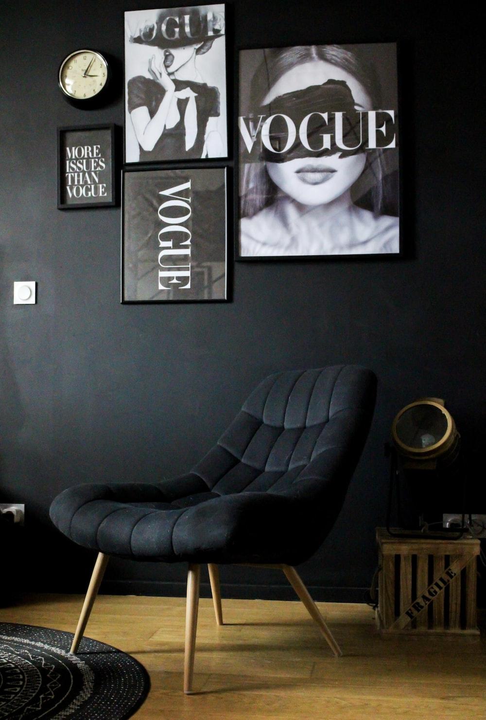 black leather armchair beside black wall