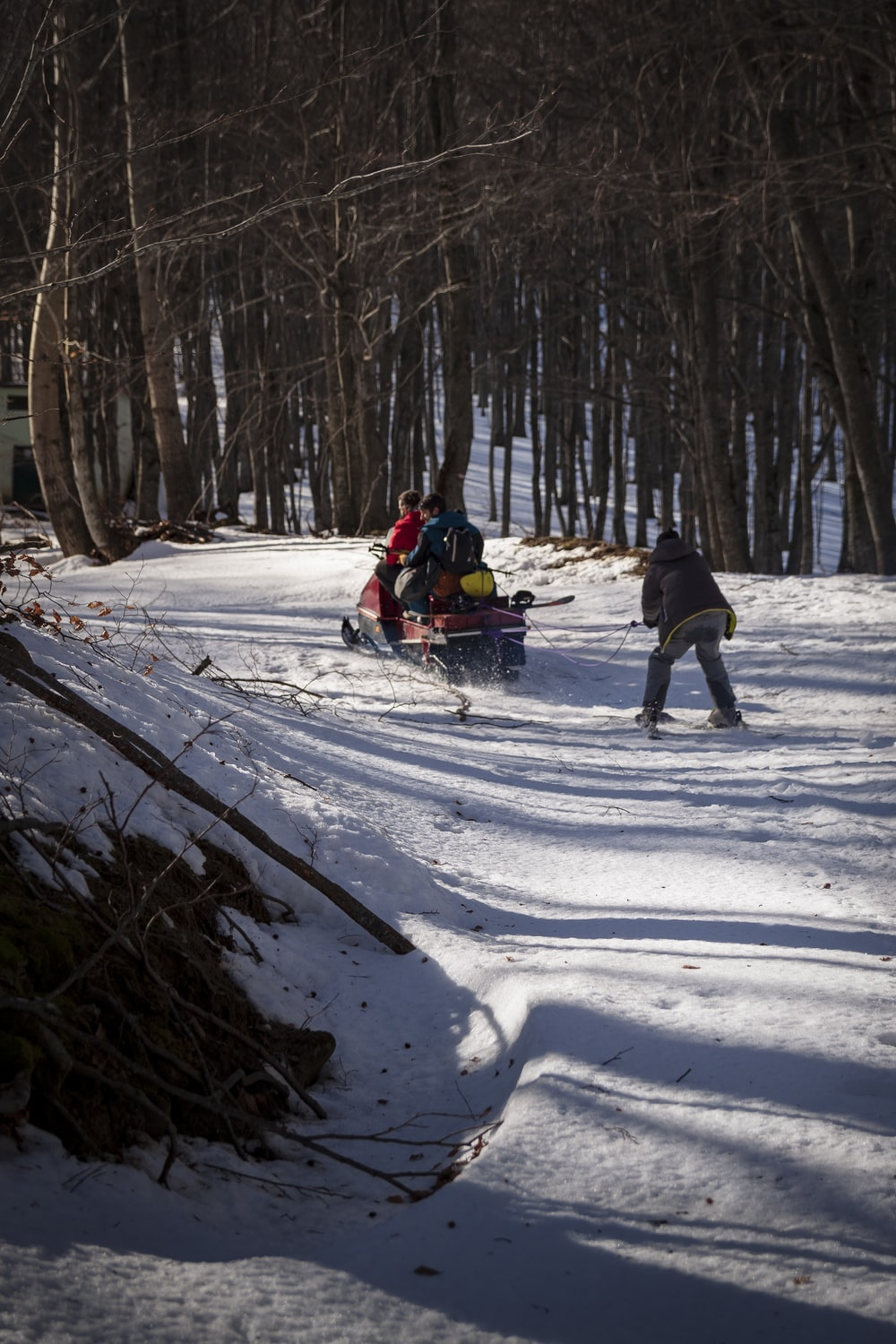 people riding ski lift on snow covered ground during daytime