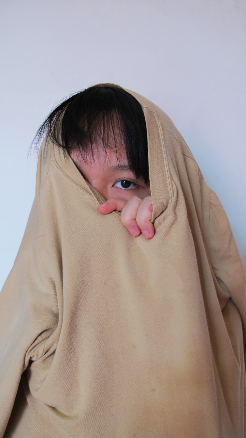 girl in brown long sleeve shirt