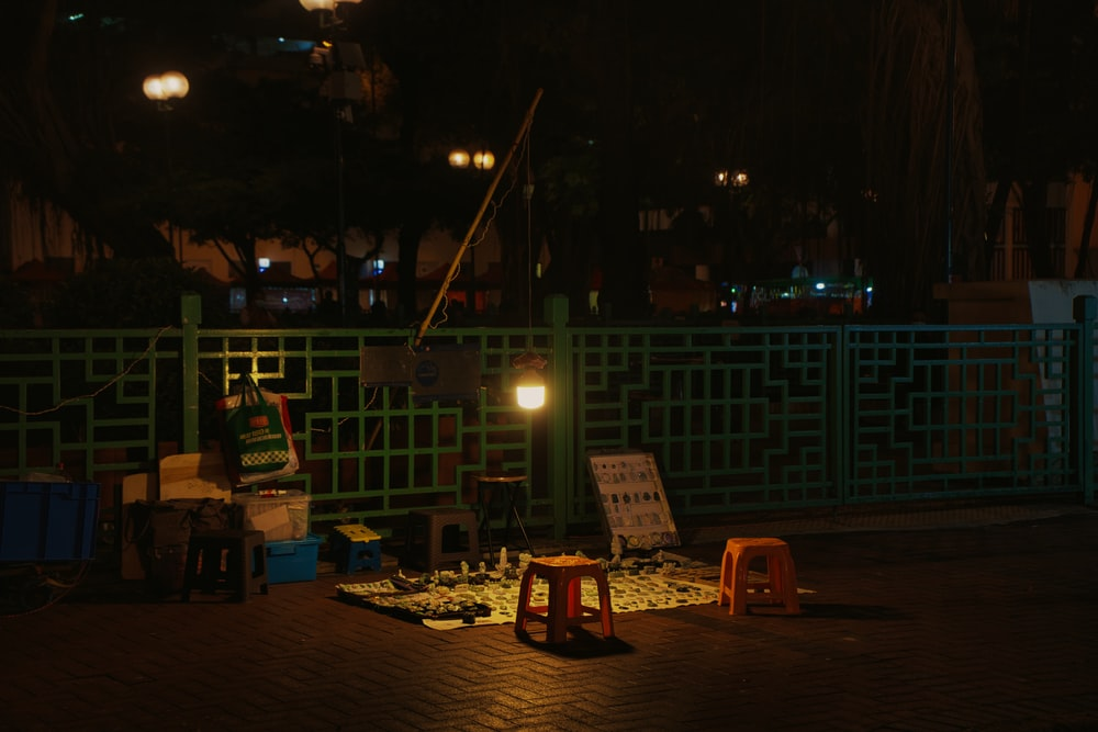 people sitting on chairs near body of water during night time