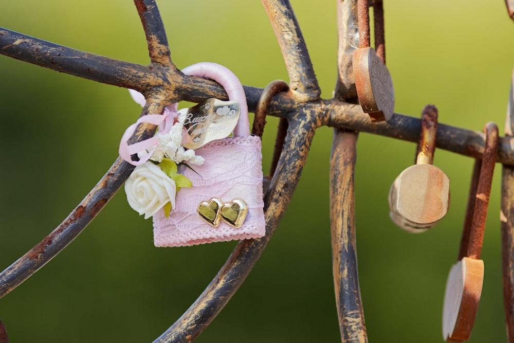 brown and gray padlock on brown metal fence