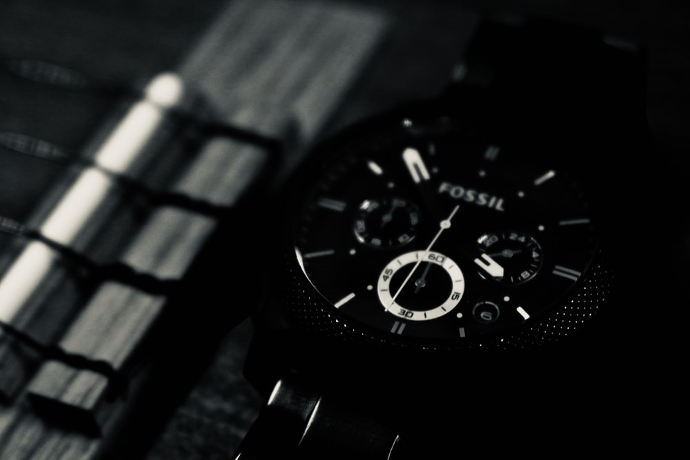 black and silver round chronograph watch