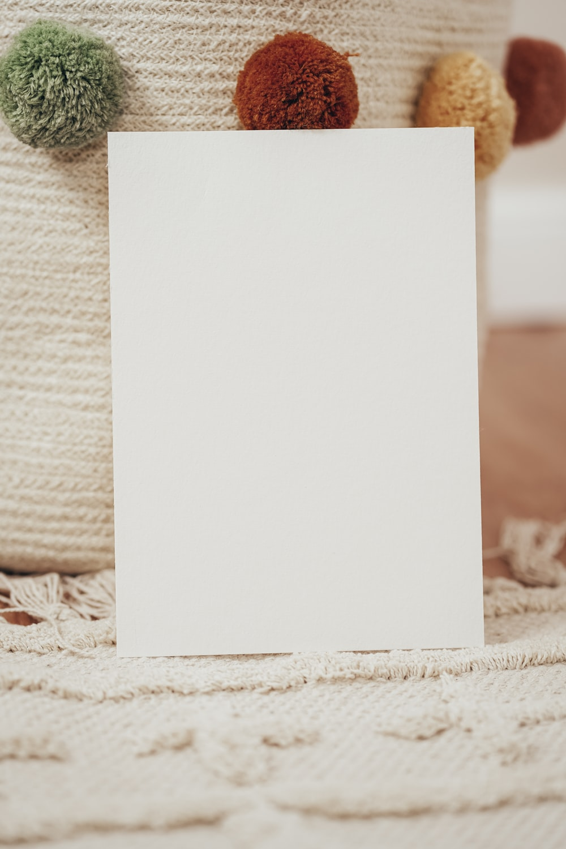 white printer paper on white textile