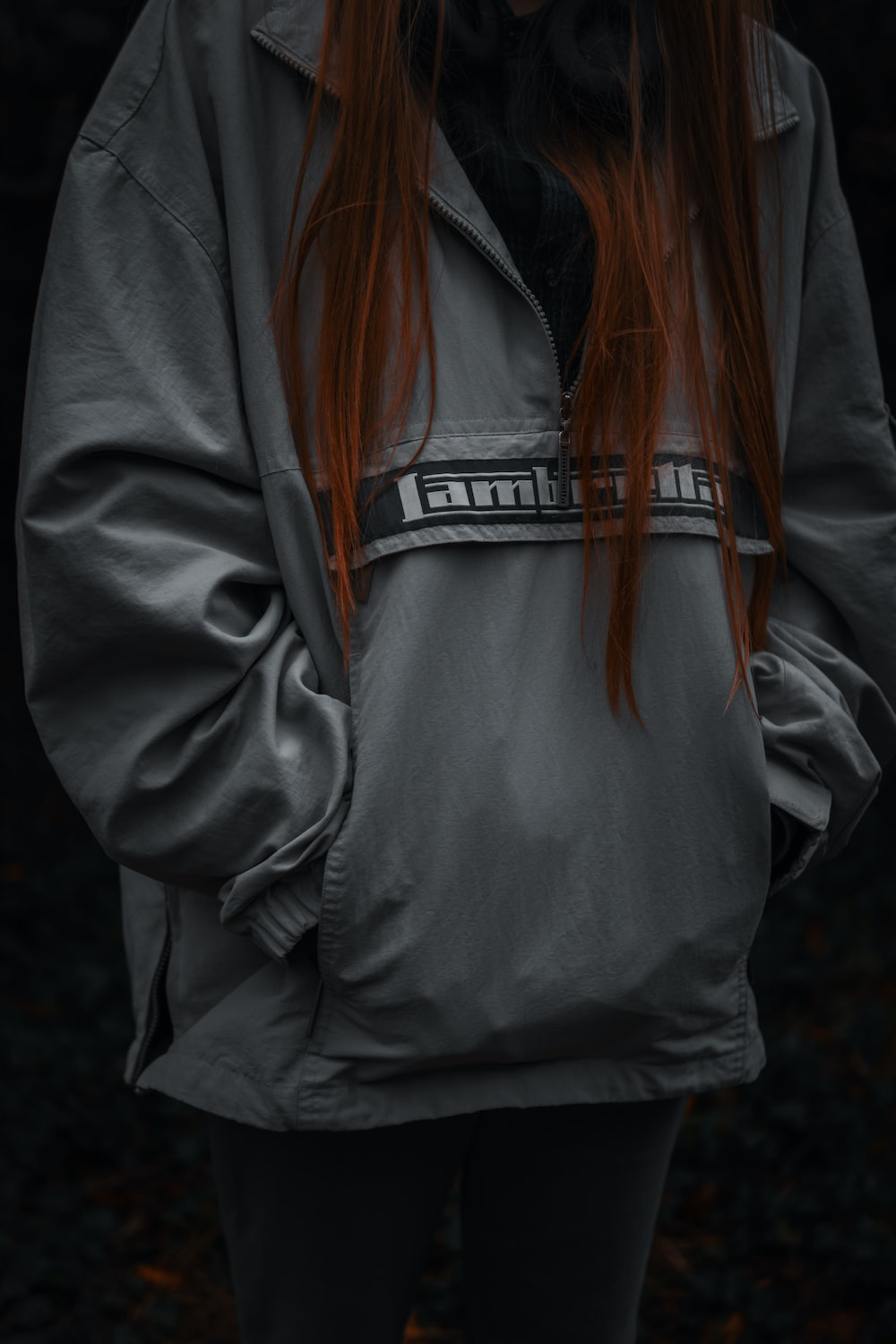 woman in gray and white zip up jacket