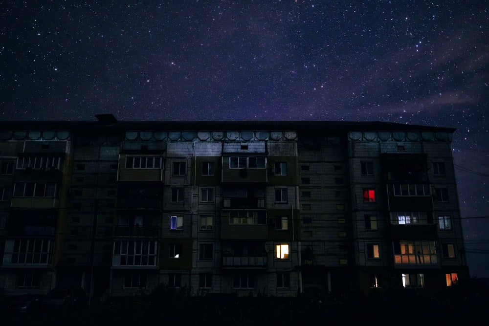 white and black concrete building under starry night