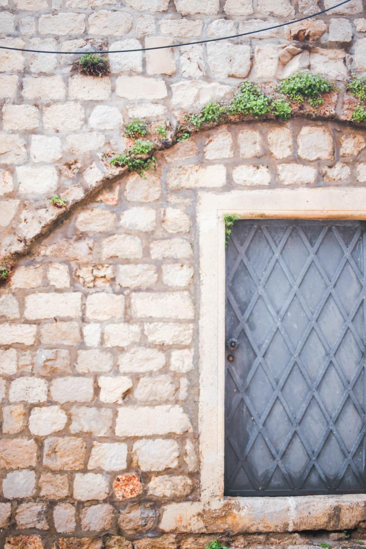 brown brick wall with blue metal window