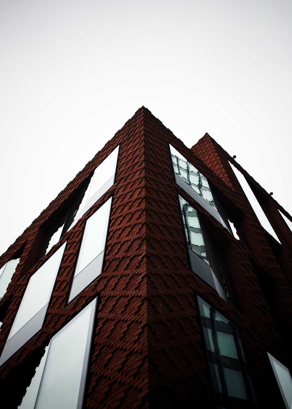 brown brick building with red metal frame